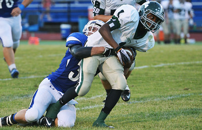 Globe/Roger Nomer Carthage's Skyler Bloomer tackles Lafayette's Rowdy Wilkinson during Friday's game in Carthage.