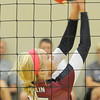 Joplin's Haley Sloan bumps the ball over the net during the Eagles' match against Carl Junction on Tuesday night at South Middle School.<br /> Globe | Laurie Sisk