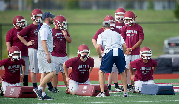 Coaches run their Eagle players through drills during the first practice of the season on Monday at JHS.<br /> Globe | Laurie Sisk
