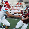 Globe/Roger Nomer<br /> Joplin's Jacob Bartlett blocks the progress of Glendale's Max Nichols during Friday's game in Joplin.
