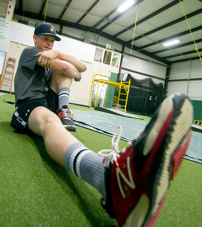 Tyler Martin, Webb City, stretches before a final bull pen session on Saturday at PlayMakers before he departs to San Diego to throw for major league scouts.<br /> Globe | Laurie Sisk