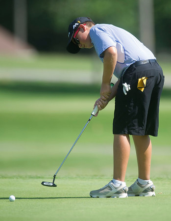 Fourteen-year-old Robbie Sager, of Carthage, putts on the no. 6 green during the Harold Kirk Junior Golf Tournament on Tuesday morning at Schifferdecker Golf Course.<br /> Globe   Laurie Sisk