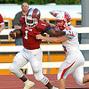 Globe/Roger Nomer<br /> Joplin's Jokiem Crawford breaks a tackle from Glendale's Dylan Green to score the Eagles' first touchdown of the season on Friday.