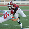 Globe/Roger Nomer<br /> Joplin's Dustin Hunter tries to avoid a tackle from Glendale's Carson Liston during Friday's game in Joplin.