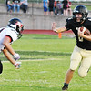 Globe/Willie Brown<br /> Neosho's Payton Klier pushes away Branson's Kyle Hunn during Friday's game in Neosho.
