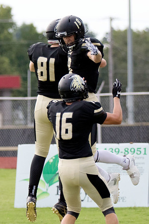 Globe|Israel Perez<br /> Neosho's Bryce Murphy (18) celebrates his touchdown with teammates Evan Talley (16) and Spencer Beardon (81) during their game on Friday night against Ozark at Neosho High School.