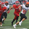 Globe/Roger Nomer<br /> Carl Junction's Zeke Wall (46) and Michael Elbert (12) try to chase down Republic's David Feil during Friday's game in Carl Junction.
