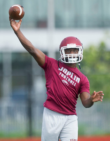 xx xx runs through drills with the quarterbacks during the first practice of the season on Monday at Joplin High School. Globe   Laurie Sisk