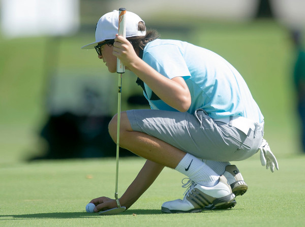 Fourteen-year-old Kolby Hosp, of Republic, lines up a putt on the no. 6 green during the Harold Kirk Junior Golf Tournament on Tuesday morning at Schifferdecker Golf Course.<br /> Globe | Laurie Sisk