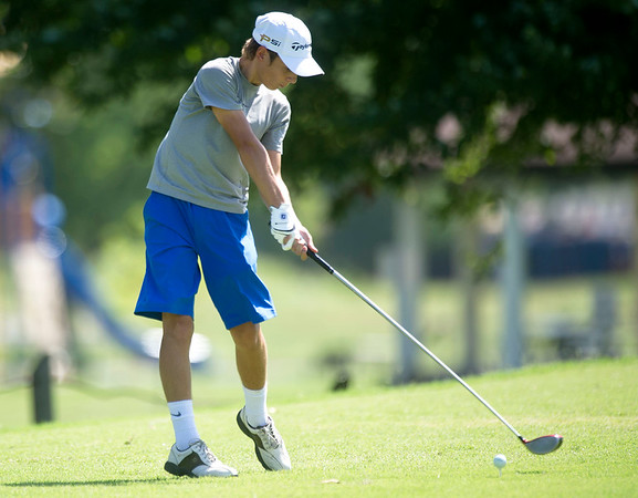Fourteen-year-old Curtis Wendler, of Mount Vernon, drives off the no. 7 tee during the Harold Kirk Junior Golf Tournament on Tuesday morning at Schifferdecker Golf Course.<br /> Globe | Laurie Sisk