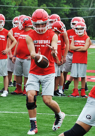 Globe/Willie Brown<br /> Davis Dills goes through a drill at Grove High School football practice on Wednesday, Aug. 9, 2017.