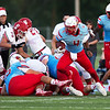 Globe|Israel Perez<br /> Will Larson (4) of Webb City runs the ball near their own goal line during their season opener game on Friday night against Carl Junction at Cardinal Stadium in Webb City.