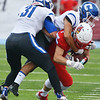 Globe/Roger Nomer<br /> Carthage's Colton Winder (31) and Blake Schrader tackle Webb City's Will Larson during Friday's game in Webb City.