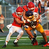 Globe/Roger Nomer<br /> Carl Junction's Colton Kennedy (22) and Aaron Ludders (17) combine to tackle Monett's Jr Villa during Friday's jamboree at David Haffner Stadium in Carthage.