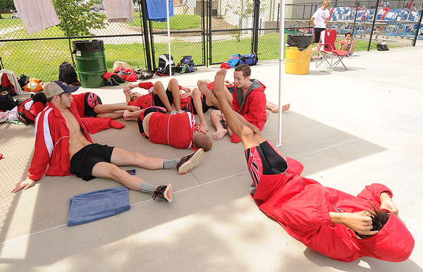 Webb City swimmers try to relax as they wait out a long delay before the start of the JAC Invite on Thursday at Schifferdecker Pool.<br /> Globe   Laurie Sisk