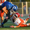 Globe/Roger Nomer<br /> Carthage's Clay Newman rushes the ball against Ozark's Easton Hanks during Friday's game at David Haffner Stadium in Carthage.