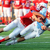 Seneca defensive lineman caleb Miller (59) tries to strip the ball from Webb City quarterback Cash Link (2) during their scrimmage on Friday night at the Webb City - Seneca- Joplin Jamboree at Webb City.<br /> Globe | Laurie Sisk