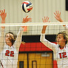 Carl Junction's Sylvia Lawson (22) and Olivia Lewis (12) try to block a spike by Joplin's Jillian Lopes during their match on Tuesday night against Carl Junction at CJHS.<br /> Globe | Laurie Sisk