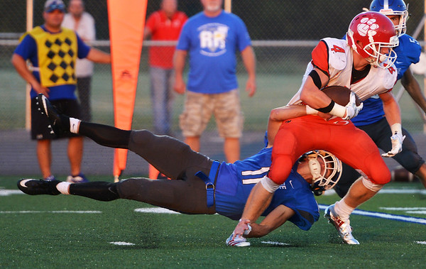 Globe/Roger Nomer<br /> Carthage's Blake Arnold tackles Ozark's Preston Carson during Friday's game at David Haffner Stadium in Carthage.