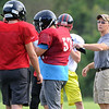 Offensive coordinator Chris Roberts works with his players during practice for the Cornerstone Spartans on Thursday night.<br /> Globe | Laurie Sisk