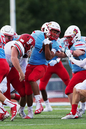 Globe Israel Perez<br /> Webb City's Terrell Kabala fights his way through the defensive line of Carl Junction during the season opener game on Friday night at Cardinal Stadium in Webb City.