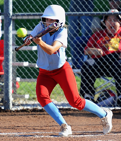 Webb City's Mariah Newby lays down a successful bunt during the Cardinals' game against Carl Junction on Wednesday night at Webb City.<br /> Globe | Laurie Sisk