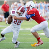 Joplin receiver Simeon Barba (22) works to get past Seneca's Alex Cook (25) during their scrimmage on Friday night at the Webb City - Seneca- Joplin Jamboree at Webb City.<br /> Globe | Laurie Sisk