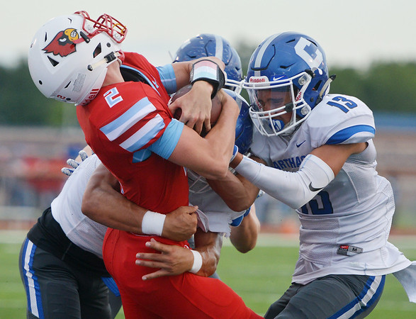 Globe/Roger Nomer<br /> Webb City's Cash Link twists out of a tackle from Carthage's Dillon Lancaster, left, and Corben Pugh to score during Friday's game in Webb City.