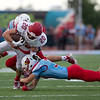 Globe|Israel Perez<br /> Lucas Berliew (20) of Carl Junction runs the ball as Webb City's Dakota Wynn tackles from below and Cade Beason tackles from behind during the season opener game on Friday night at Cardinal Stadium in Webb City.