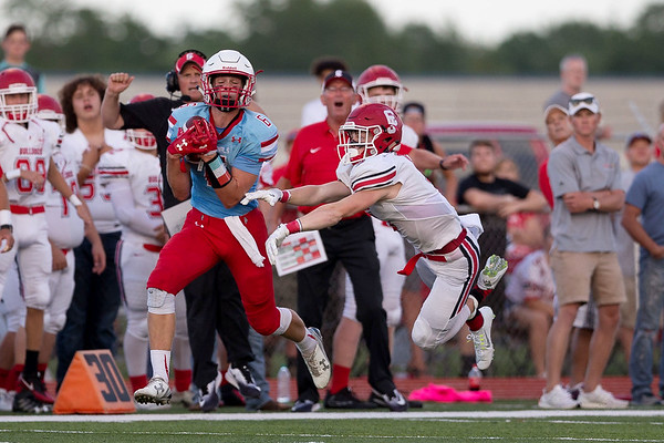 Globe|Israel Perez<br /> Alex Gaskill (6) of Webb City catches the ball at the 30 yard line as Tyler White of Carl Junction tries to block the catch during their season opener game on Friday night at Cardinal Stadium in Webb City.