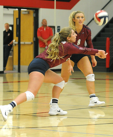 Joplin's Jessica Zengel (24) returns a serve as teammate Caroline Lieurance (8) looks on during their match on Tuesday night against Carl Junction at CJHS.<br /> Globe | Laurie Sisk