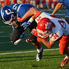 Globe/Roger Nomer<br /> Carthage's Corben Pugh rushes the ball against Ozark's Cade Little during Friday's game at David Haffner Stadium in Carthage.