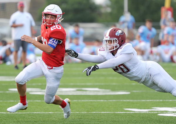 Seneca receiver Max Roark gets past Joplin's Isaiah Davis during their scrimmage on Friday night at the Webb City - Seneca- Joplin Jamboree at Webb City.<br /> Globe | Laurie Sisk