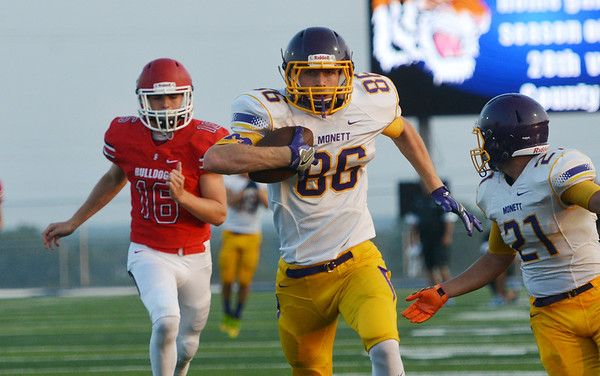 Globe/Roger Nomer<br /> Monett's Zach Blevins runs away from the Carl Junction defense to score during Friday's jamboree at David Haffner Stadium in Carthage.