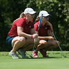 Globe/Roger Nomer<br /> Joplin's Kaitlyn Gilliland, left, and Anna Iorio, seniors, consult on a putt on Monday at Briarbrook Golf Course.