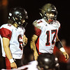 Lamar's Stuart McKarus (17) waits for the snap with co-quarterback Duncan Gepner (6) during their season opener at Cassville.<br /> Globe | Laurie Sisk