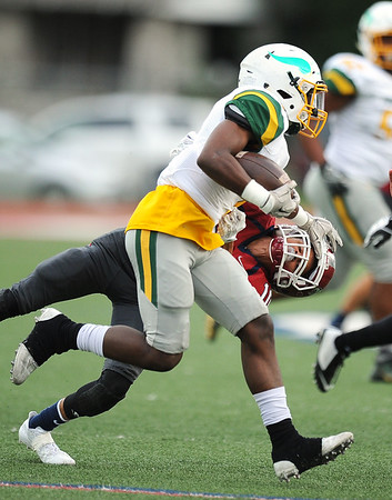 Parkview's Demarcus Mason (1) tries to get past Joplin's DaRon Morgan (10) during their game on Friday night at Junge Stadium.<br /> Globe   Laurie Sisk