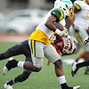 Parkview's Demarcus Mason (1) tries to get past Joplin's DaRon Morgan (10) during their game on Friday night at Junge Stadium.<br /> Globe | Laurie Sisk