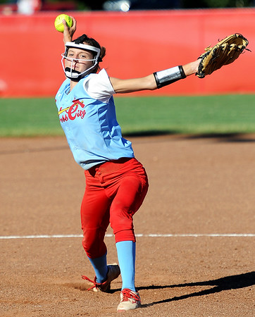 Webb City's Kaylee Cristy throws from the circle during the Cardinals' game against Carl Junction on Wednesday night at Webb City.<br /> Globe   Laurie Sisk
