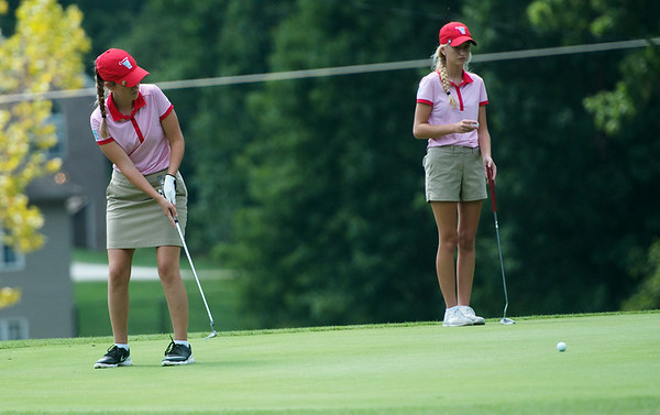 Globe/Roger Nomer<br /> Webb City's Macy McAllister, junior, putts as teammate Emma Oathout, senior, waits on Monday at Briarbrook Golf Course.