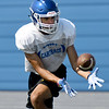Senior receiver Arkell Smith pulls down a pass during practice on Friday at Carthage High School.<br /> Globe | Laurie Sisk