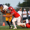 Globe/Roger Nomer<br /> Carl Junction's Ian Margeson tackles Monett's Jr Cavazos during Friday's jamboree at David Haffner Stadium in Carthage.