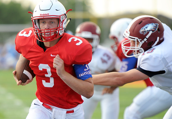 Seneca quarterback Gavin Clouse (3) gets past Joplin's Luke Kuehnel (19) during their scrimmage last Friday night at the Webb City - Seneca- Joplin Jamboree at Webb City.<br /> Globe | Laurie Sisk