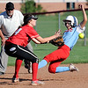 Webb City's Mariah Newby slides into second base on a steal as Carl Junction shortstop Madison Bowers fields the throw during their game on Wednesday night at Webb City.<br /> Globe | Laurie Sisk