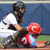Webb City's Ashley Alexander (10) slides under the tag of Joplin catcher Joplin catcher Mikayla Kuehnel during their game on Tuesday at Joplin High School.<br /> Globe | Laurie Sisk