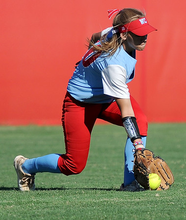 Webb City centerfielder catches up to a ground ball during the Cardinals' game against Carl Junction on Wednesday night at Webb City.<br /> Globe | Laurie Sisk