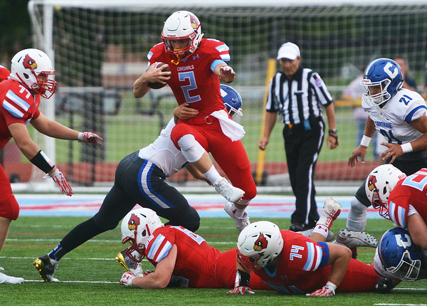 Globe/Roger Nomer<br /> Webb City's Cash Link jumps out of the backfield during Friday's game against Carthage at Webb City.