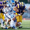 Globe|Israel Perez<br /> Sarcoxie's Chris Comerford (1) drags Kolbe Dean (65) of Commerce as Comerford rushes the ball to the end zone during their game on Friday night at Sarcoxie High School