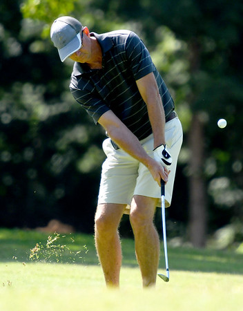 Greg Crawford hits a chip shot onto the no. 2 green at Briarbrook on Saturday during the Joplin Area champioships.<br /> Globe   Laurie Sisk
