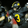 Globe/Laurie Sisk<br /> Cassville's DJ White follows blocker Bowen Preddy during Friday's game against Lamar in Cassville.
